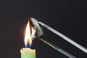 Lead heated in a candle flame