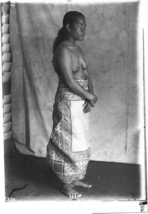 Bikini Atoll - A woman named Liijabor from Likiep Island, Likiep Atoll in the Marshall Islands, wears a traditional nieded or  clothing mat circa 1918