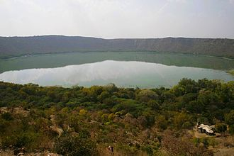 Lonar crater lake - View of the crater from the edge.   A temple is visible in the forest underneath.