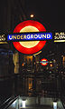 London Underground roundel at Monument station at night (8221277371).jpg