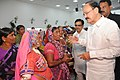M. Venkaiah Naidu interacting with the Banjara Tribal women, at the inauguration of free medical camp, organised by the Swarna Bharat Trust, in Hyderabad.jpg