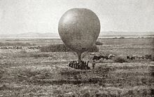 Contemporary image of a tethered, round observation balloon being prepared for use