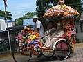 Malaysia - Malaka - 19 - bright and gaudy rickshaw (6320834312).jpg