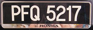 Vehicle registration plates of Malaysia - A standard Peninsular Malaysian number plate, registered in Penang and affixed on a dealership plate frame.