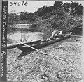 Man in dug out canoe (3608378508).jpg
