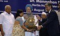 Manmohan Singh giving away the Special National Award for SCST Entrepreneur in Micro & Small Enterprises to Smt. Papari Mandal of West Bengal, at the presentation of National Awards-2007 for Micro, Small & Medium Enterprises.jpg