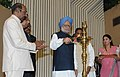 Manmohan Singh lighting the lamp at the presentation ceremony of the National Awards to the Micro, Small & Medium Enterprises, in New Delhi. The Minister of State (Independent Charge) for Micro, Small & Medium Enterprises.jpg