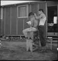 Manzanar Relocation Center, Manzanar, California. Common sight during the long summer evenings afte . . . - NARA - 538084.tif