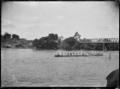 Maori waka on the Waikato River at the Ngaruawahia Regatta. ATLIB 287515.png