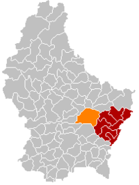 Map of Luxembourg with Junglinster highlighted in orange, and the canton in dark red