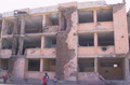 March 2002 photo of destruction to Sultan Razia school.PNG