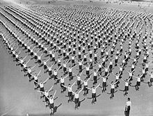Black and white photograph of Royal Air Force recruits going through physical training.