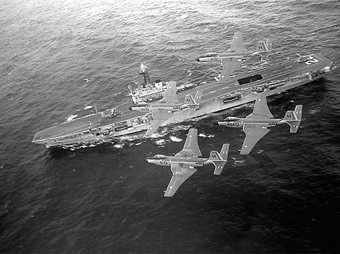 McDonnell F2H-3 Banshees in flight over HMCS Bonaventure (CVL 22), in the late 1950s