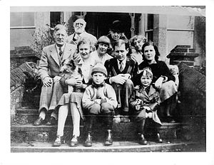 Battiscombe Gunn - Family picture in 1935 Back Row: Charles S. Meacham (chemist, brewer, painter), Florence Meacham (painter) Second Row: Battiscombe Gunn, son in law (Egyptologist), Wendy Wood, daughter (Scottish nationalist), Meena Gunn, daughter (Freudian psychoanalyst) Third Row: Mary Barnish, granddaughter, with Meena's dog, Spike Hughes, grandson (musician, critic), Bobbie Hughes granddaughter-in-law Fourth (front) Row: J. B. Gunn, grandson (physicist), Angela Hughes, great-granddaughter.