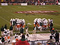 Miami in huddle at 2008 Emerald Bowl.JPG