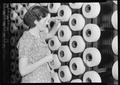 Millville, New Jersey - Textiles. Millville Manufacturing Co. (Woman standing at large spools of thread.) - NARA - 518675.tif