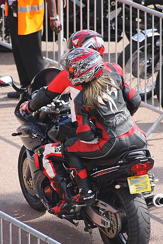 Motorcycle personal protective equipment - A rider and passenger wearing racing leathers.