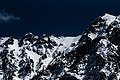 Mountain with snow near dark skies (Unsplash).jpg