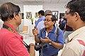 Mrinal Pal Discussing with Himadri Sanker Mazumdar and Asim Kumar Poddar - PAD Group Exhibition - Kolkata 2017-06-20 0206.JPG