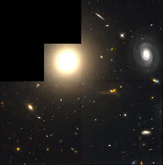 NGC 4881 - Elliptical Galaxy NGC 4881 (center) and the Spiral galaxy PGC 44691 (right).