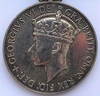 Distinguished Service Medal (United Kingdom) - Image: NGSM 1915 GVI obv 1949 52