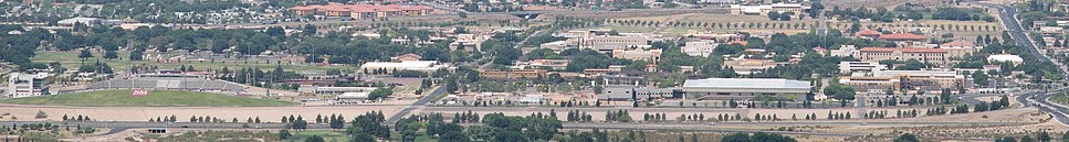 """New Mexico State University's main campus, with Aggie Memorial Stadium on the left, and the primary """"colleges"""" on the right, along University Avenue"""