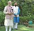 Narendra Modi addressing after planting a Kadamb sapling (Neolamarckia Cadamba), at the Race Course Road lawns, to mark the occasion of the World Environment Day, in New Delhi. The Minister of State for Environment.jpg