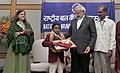Narendra Modi conferring the National Awards for Bravery 2014 to Aqil Mohammad NK from Kerala who swam & rescued a 3.5 yr old girl from drowning, in New Delhi. The Union Minister for Women and Child Development.jpg