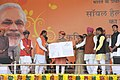 Narendra Modi giving 'Soil Health Card' to a farmer at the launch of the 'Soil Health Card Scheme', at Suratgarh, in Rajasthan. The Union Minister for Agriculture, Shri Radha Mohan Singh, the Chief Minister of Rajasthan.jpg