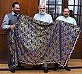 Narendra Modi hands over Chaadar to be offered at Dargah Khwaja Moinuddin Chishti Ajmer Sharif to the Minister of State for Minority Affairs (Independent Charge) and Parliamentary Affairs.jpg