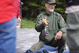 National Park Service biologist Chris Ulrey distributing rappelling gear (9406099057).jpg
