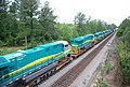 New GE locomotives transported on flat cars for export • 11.jpg