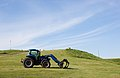 New Holland tractor with NH 850 TL FEL, South Dakota.jpg