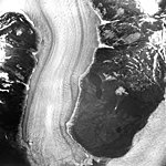 Norris Glacier, terminus of valley glacier at the lower left, trim line on the valley walls, and the Taku Glacier visible in the (GLACIERS 6038).jpg