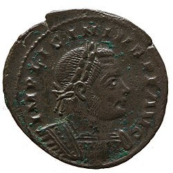 Brown coin depicting man with diadem facing right