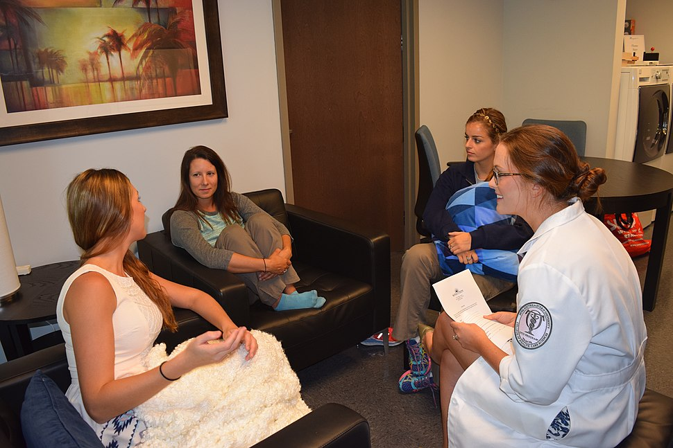 Occupational therapist conducting a group intervention on interpersonal relationship building