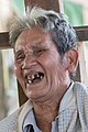 Old man laughing out loud in Don Det.jpg
