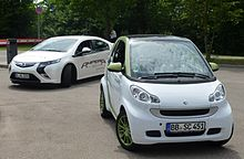 Smart Ed All Electric Car Right And Opel Ampera Plug In Hybrid Left Germany