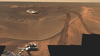 Opportunity (rover) - Real image of Eagle Crater, Opportunity lander, and wheel tracks, as seen by MER-B Opportunity in 2004 from planet Mars.