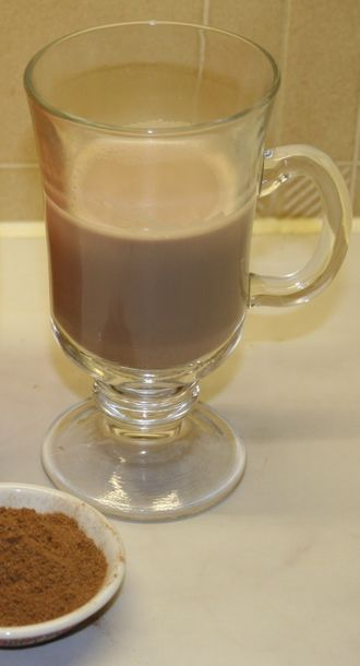 Ovaltine - A mug of ovaltine made with hot milk, and a tablespoon of the powder