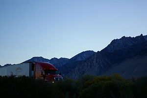 U.S. Route 395 in California - Truck passing through Owens Valley with the Sierra Nevada in the background