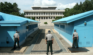 Joint Security Area - South Korean soldiers standing guard at the JSA between the blue buildings. View from the south, with North Korea to the rear.