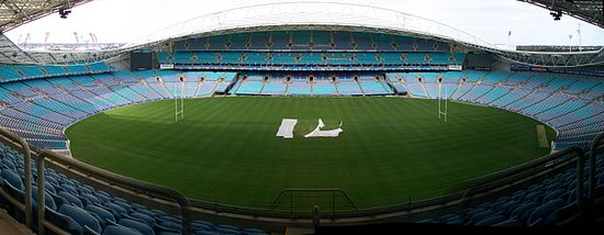 ANZ Stadium with seats arranged in its oval configuration (for Australian rules football and cricket). The seats in the centre of the picture can be moved closer to the field, to create a rectangular configuration (suitable for football (soccer) and the rugby codes).