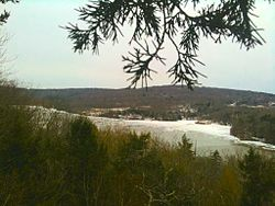 Partially frozen Lake Zoar viewed from the Pomperaug Trail just south of Oxford Connecticut's Jackson Cove Town Park.
