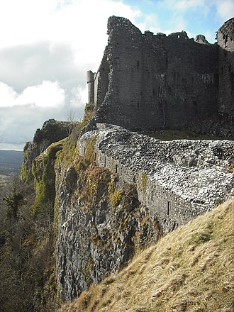 Carreg Cennen Castle - The cliff below the castle, and the windows of the passage to the cave