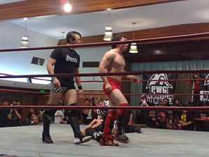 T. J. Perkins - Perkins (left) with regular tag team partner Hook Bomberry in the ring at Pro Wrestling Guerrilla's Scared Straight in 2008.