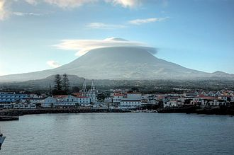 Madalena, Azores - The vista off the coast of Madalena parish, showing the profile of the stratovolcano Pico and settlement of the municipal seat