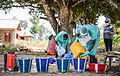 Pictured are personnel laying out buckets of chlorinated water ready for the decontamination of a property MOD 45158995.jpg