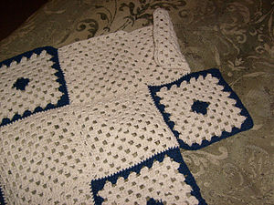 Granny square - An Afghan blanket of granny squares during piecework assembly