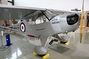 RAF Benevolent Fund - Piper J-3 Flitfire, auctioned for the RAFBF (visible on the tail section), on display at the North Carolina Aviation Museum